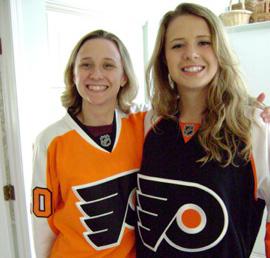 Two people wearing Flyers Jerseys